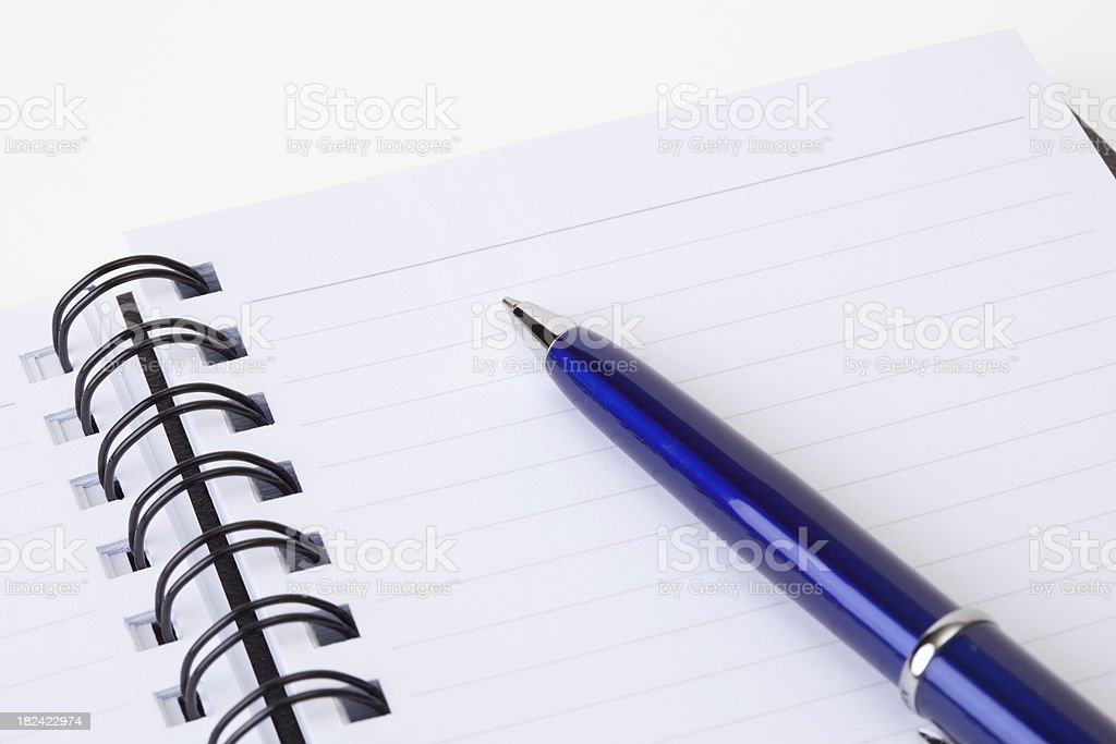 Closeup of blank notebook paper with a pen royalty-free stock photo