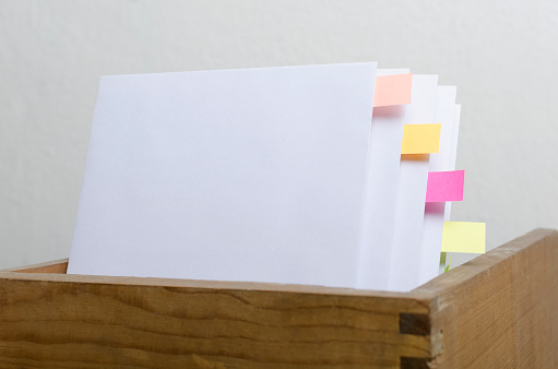 668340340 istock photo Closeup of blank paper, bookmarks.Concept of organization of documentation 1192061802