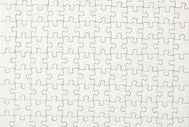 Close-up of blank white jigsaw puzzle texture background. stock photo