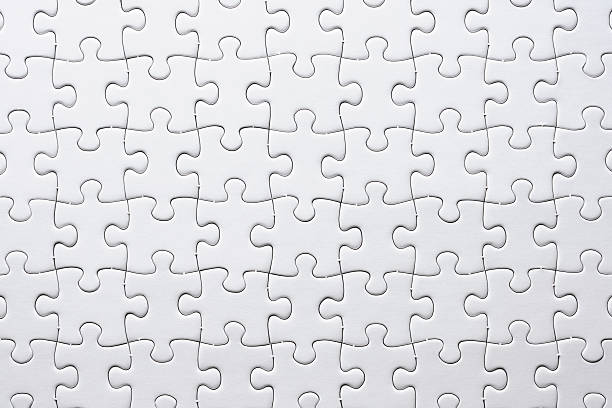close-up of blank white jigsaw puzzle texture background - jigsaw puzzle stock photos and pictures