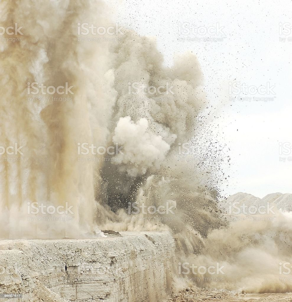 Close-up of blast in an open pit causing thick smokes royalty-free stock photo