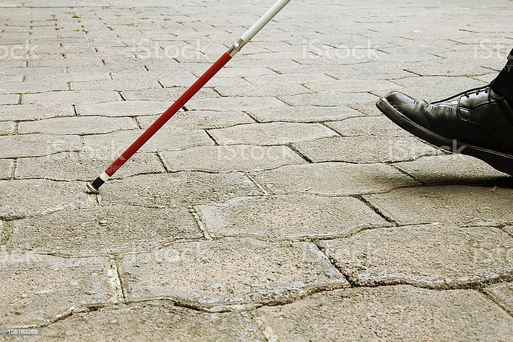 Closeup of Blind Man Walking With White Cane stock photo