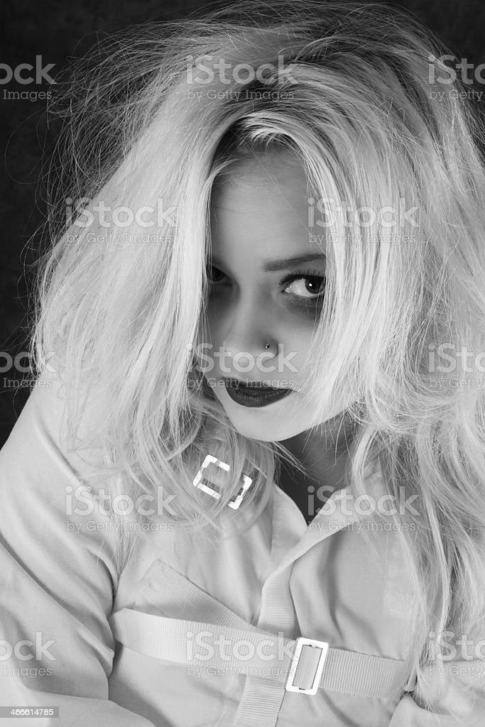 B&W closeup of blonde teen in straitjacket. royalty-free stock photo