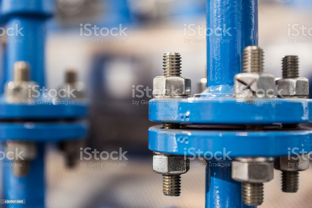 Close-up of blue machine at factory stock photo