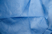 Close-up of blue medical non-woven fabric cloth