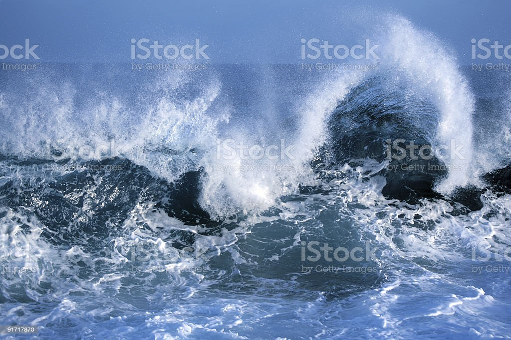Close-up of blue ocean waves crashing against one another royalty-free stock photo