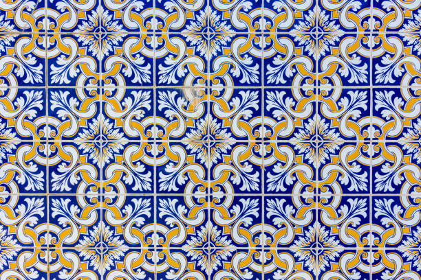Close-up of blue, white and yellow ceramic wall tiles in Tavira, Portugal stock photo