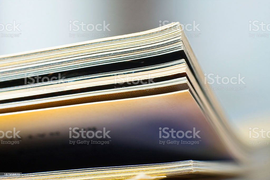 Close-up of blurred magazine pages with crisp edges stock photo
