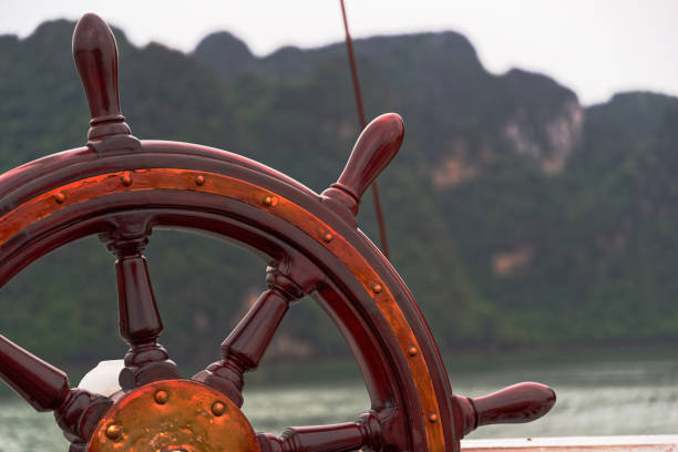 Close-up of Boat steering wheel against mountains in the distant stock photo