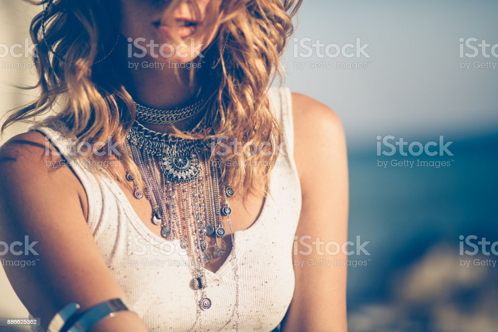 Close-up of bohemian woman wearing silver fashionable jewelry stock photo