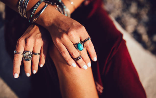 Close-up of bohemian woman's hands with silver jewelry stock photo