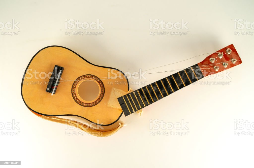 Close-up of borken classic guitar royalty-free stock photo