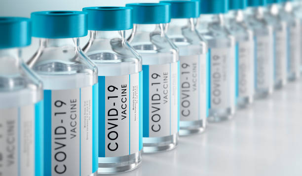 Close-up of bottles of COVID-19 vaccine Row Covid-19 or Coronavirus vaccine flasks on white background covid vaccine stock pictures, royalty-free photos & images