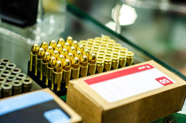 Close-up of box 9mm ammo Close-up of box 9mm ammo ammunition stock pictures, royalty-free photos & images