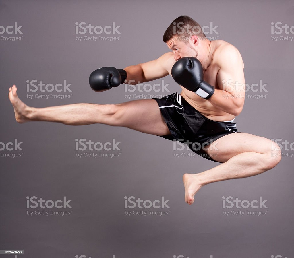 Close-up of boxer exercising kickboxing royalty-free stock photo