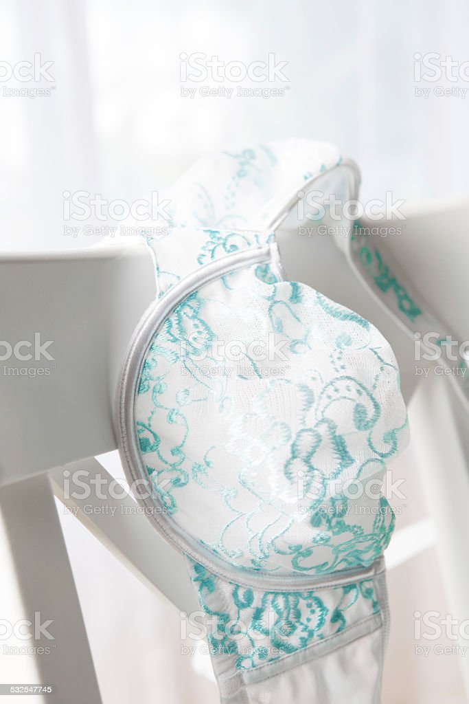 Close-up of bra on chair stock photo