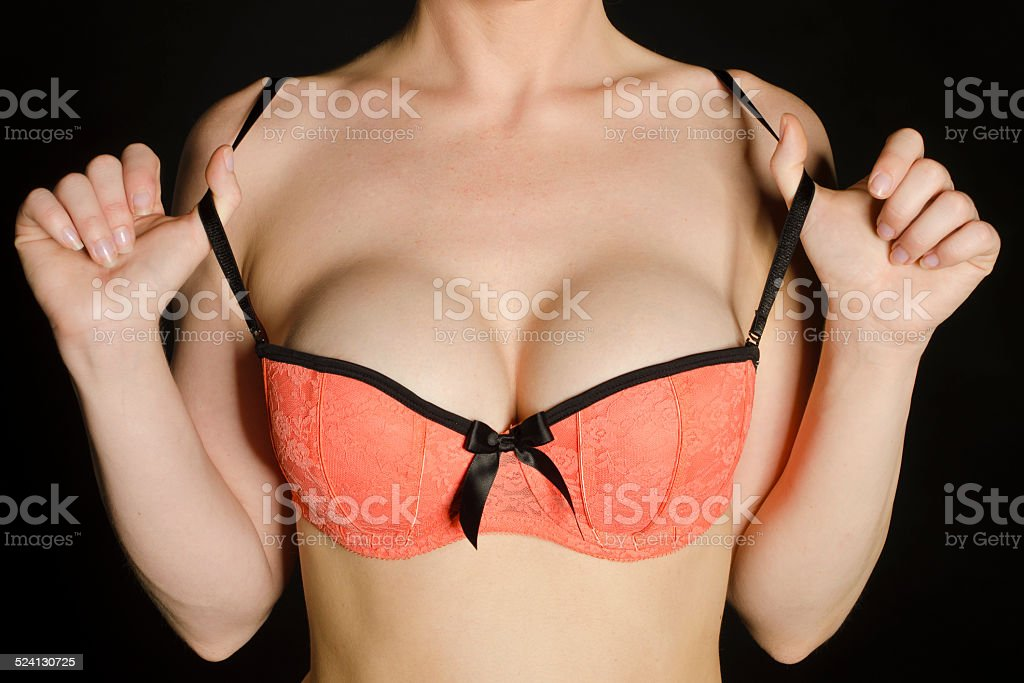 Close-up of breast enlargement and bra stock photo