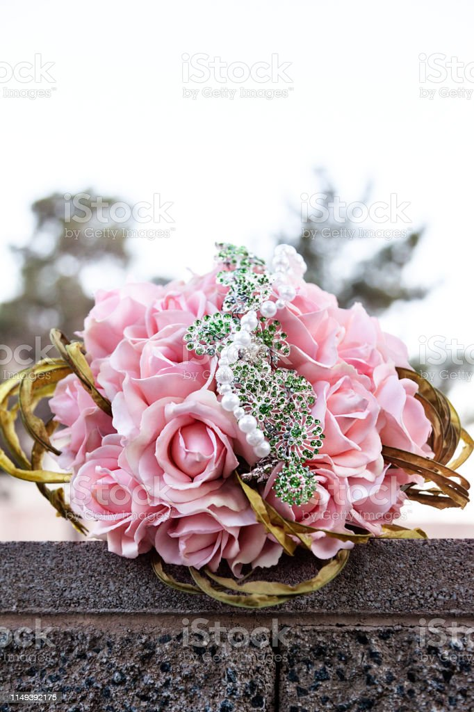Closeup of bride wedding bouquet of pink roses on a wedding day outdoor stock photo