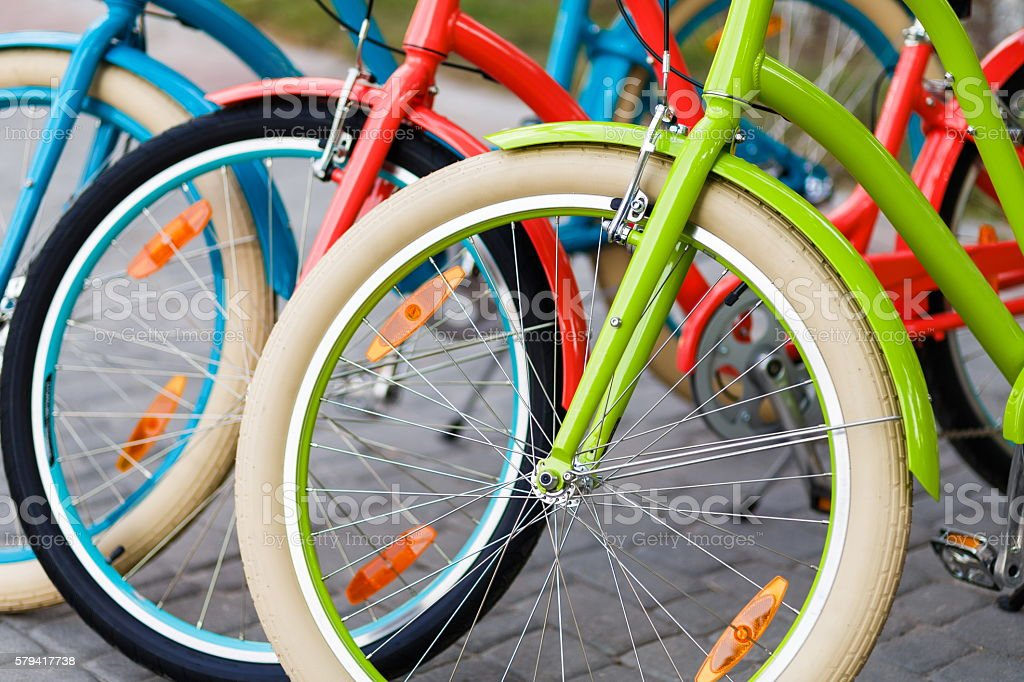 Closeup of bright colored city woman bikes outdoors stock photo