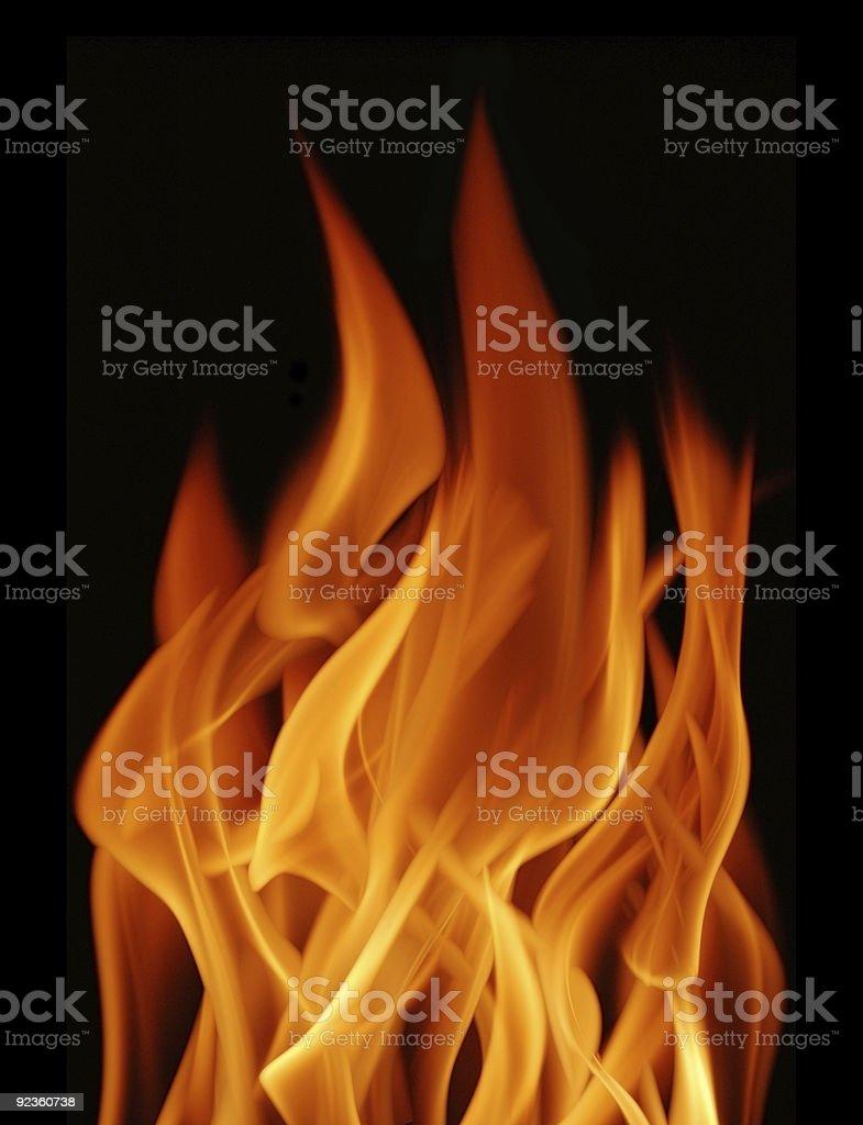Close-up of bright orange flame on black background stock photo