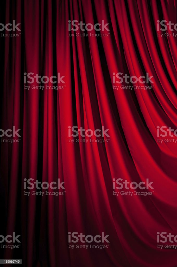 Close-up of bright red velvet curtain drape royalty-free stock photo