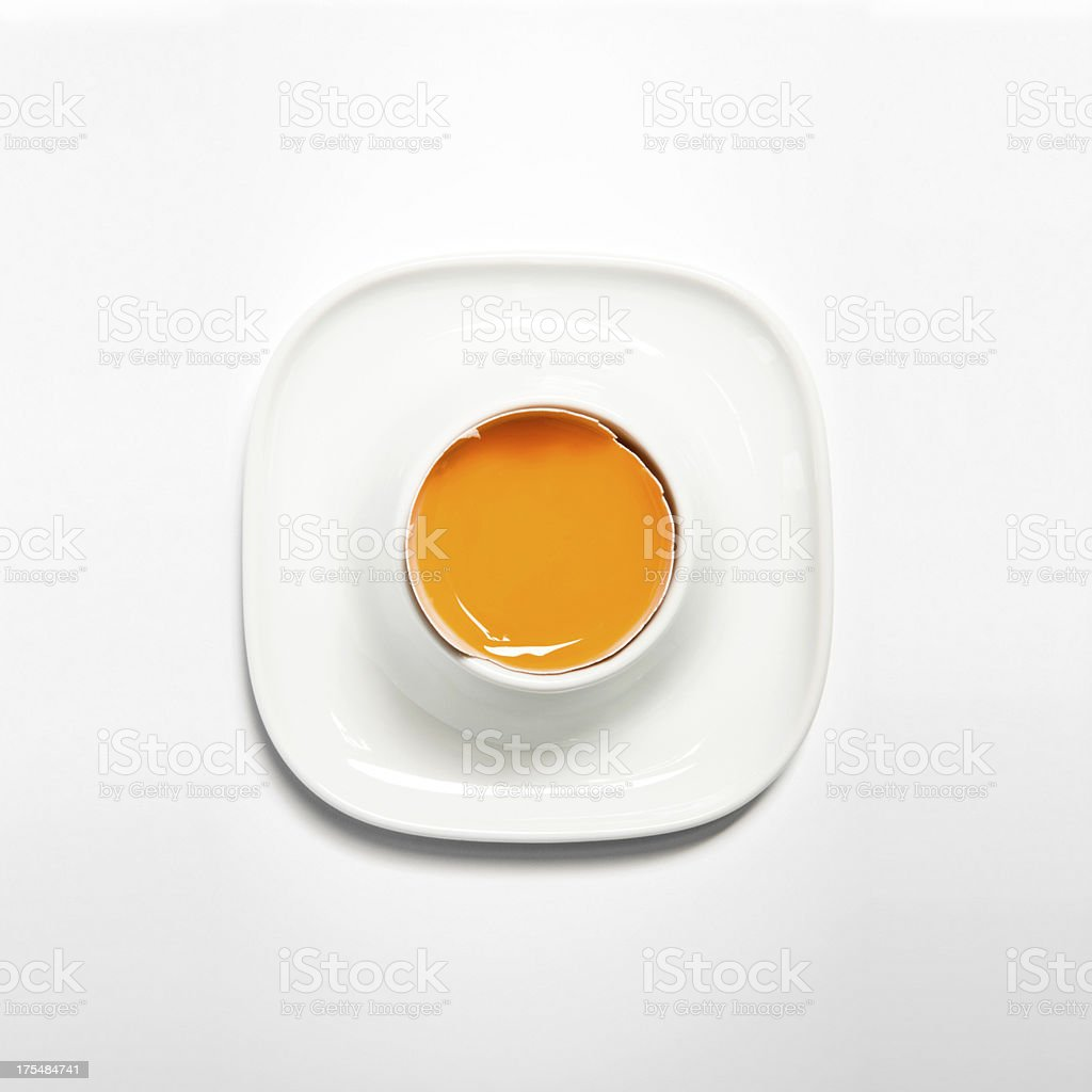 Close-up of broken raw egg in an eggcup, above, isolated stock photo