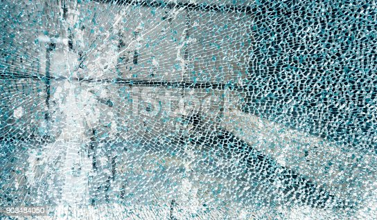 istock Close-up of broken window glass 908484050