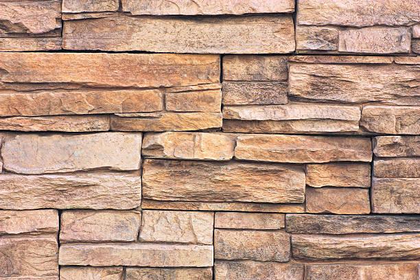 Closeup of brown and tan flagstone wall  stock photo