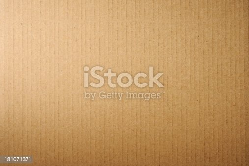 Close-up of brown cardboard texture background.
