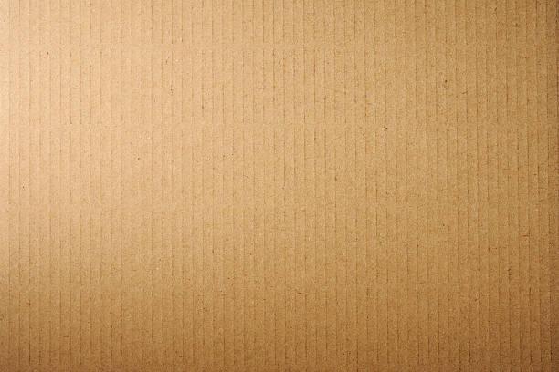 close-up of brown cardboard texture background - cardboard texture stockfoto's en -beelden