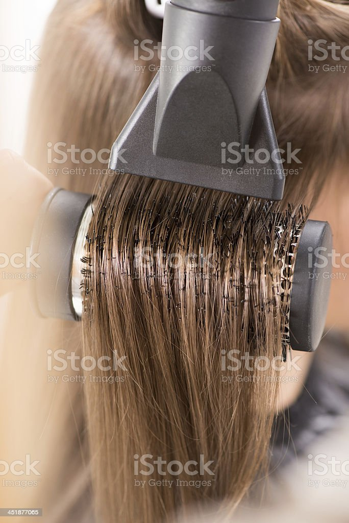 Close-up of brown hair being dried stock photo