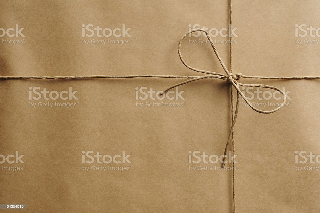 Close-up of brown package with string stock photo