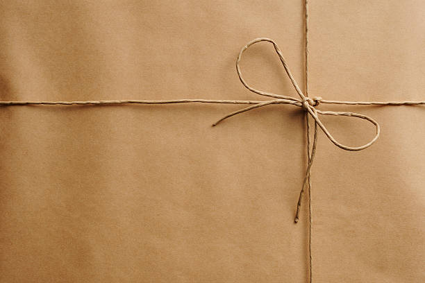 Close-up of brown package with string foto