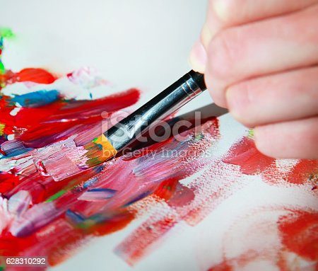 istock Closeup of brush and palette. 628310292