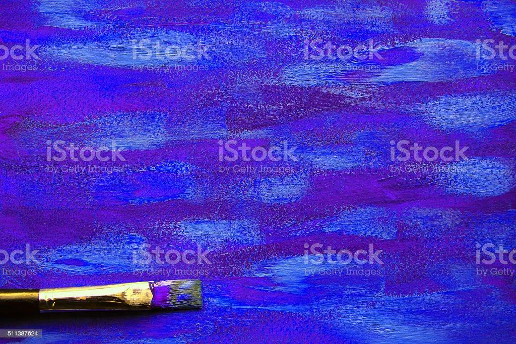 Closeup of brush on blue painting stock photo