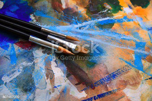 istock Closeup of brushes and palette 507457020