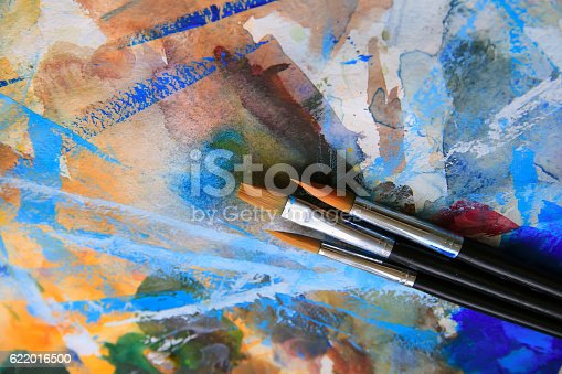 istock Closeup of brushes and palette. 622016500