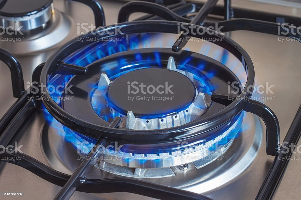 Closeup of burning gas burner of stove stock photo