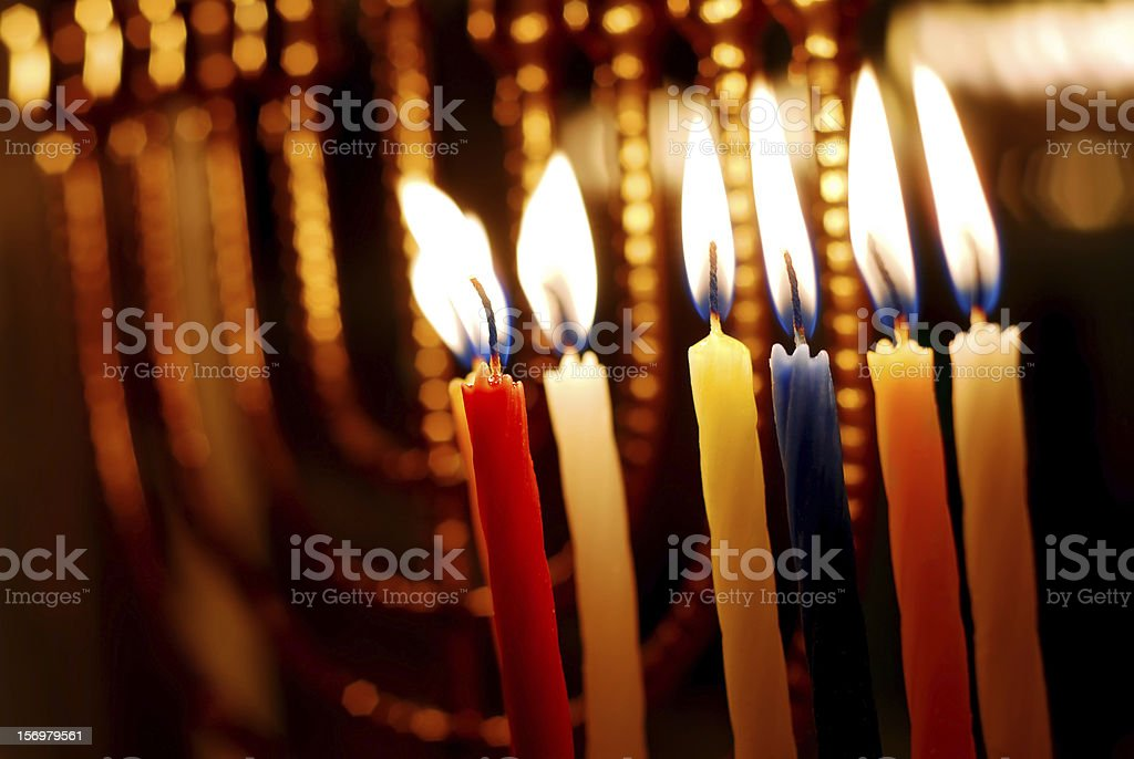Close-up of burning Hanukkah candles in the dark stock photo