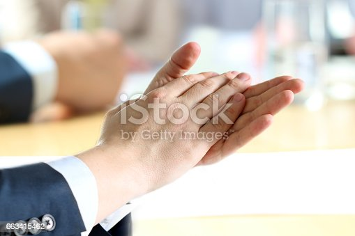 497183120 istock photo Close-up of business man clapping hands. Business seminar concept 663415462