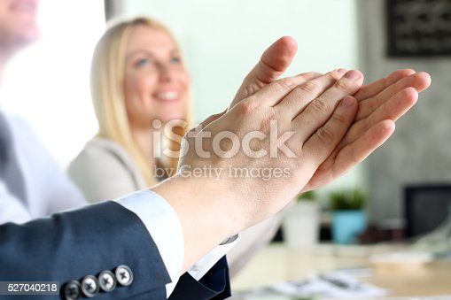 497183120 istock photo Close-up of business people clapping hands. Business seminar concept 527040218