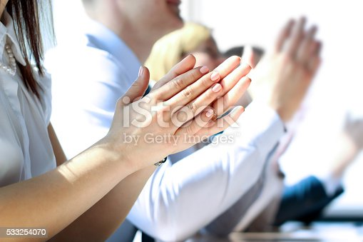497183120 istock photo Close-up of business people clapping hands. Business seminar concept 533254070