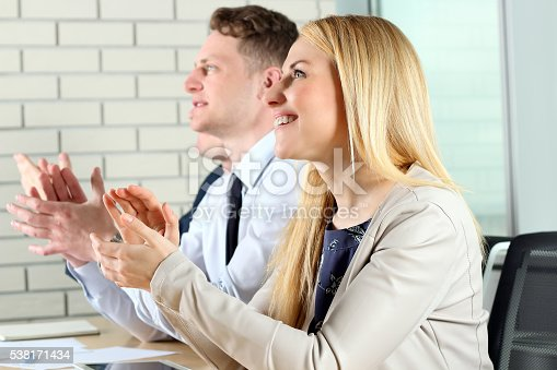 497183120 istock photo Close-up of business people clapping hands. Business seminar concept 538171434