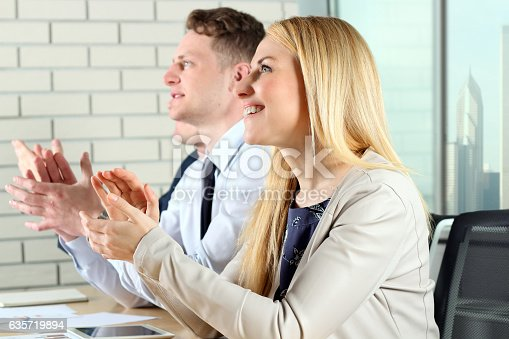 497183120 istock photo Close-up of business people clapping hands. Business seminar concept 635719894
