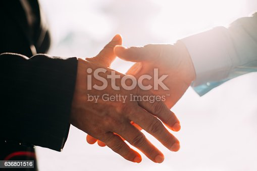 istock Close-up of business people hands shaking 636801516
