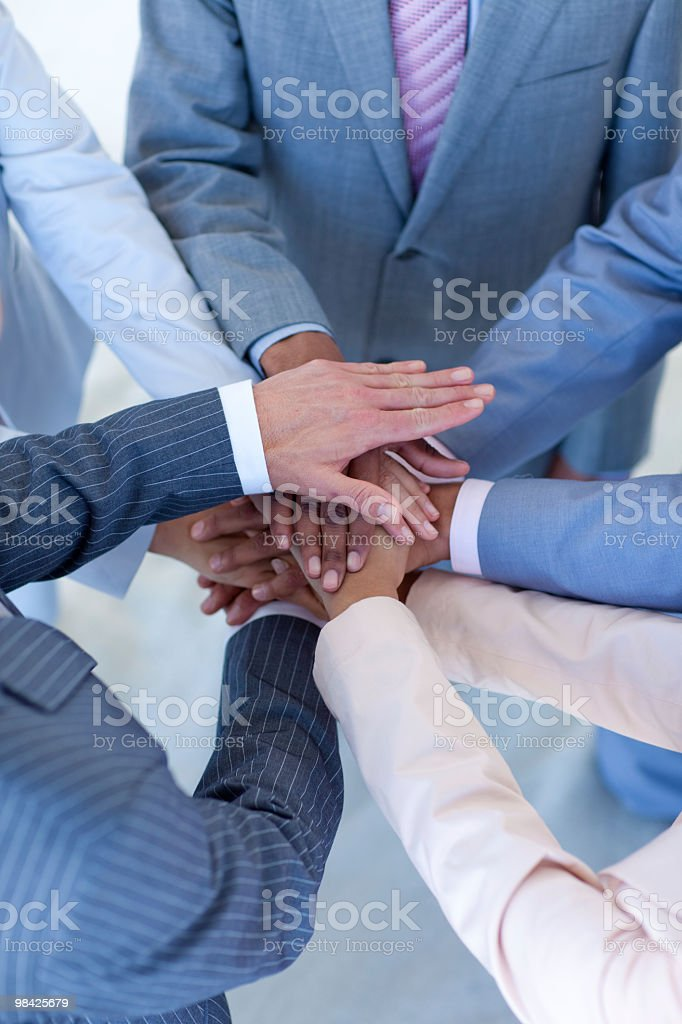 Close-up of business people with hands together royalty-free stock photo
