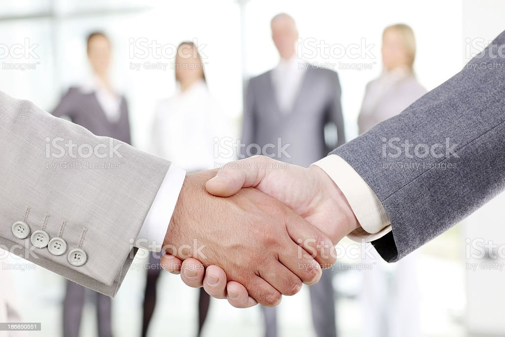 Close-up of business people`s arms handshaking. royalty-free stock photo
