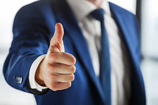 closeup of business person showing thumb up. - thumbs up стоковые фото и изображения
