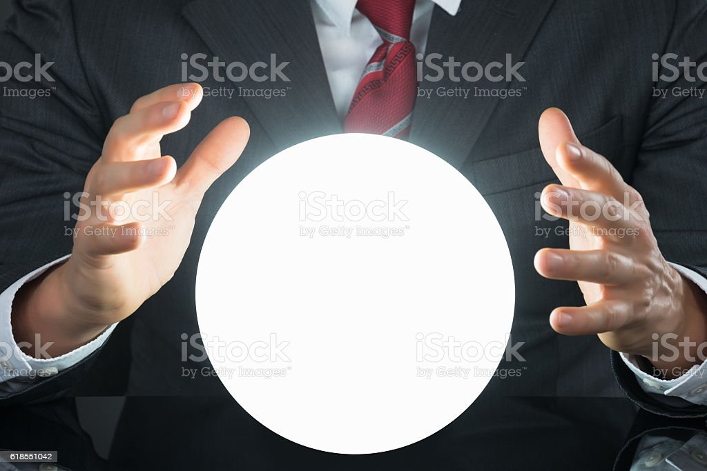 Close-up Of Businessman Hand On Crystal Ball - foto de stock