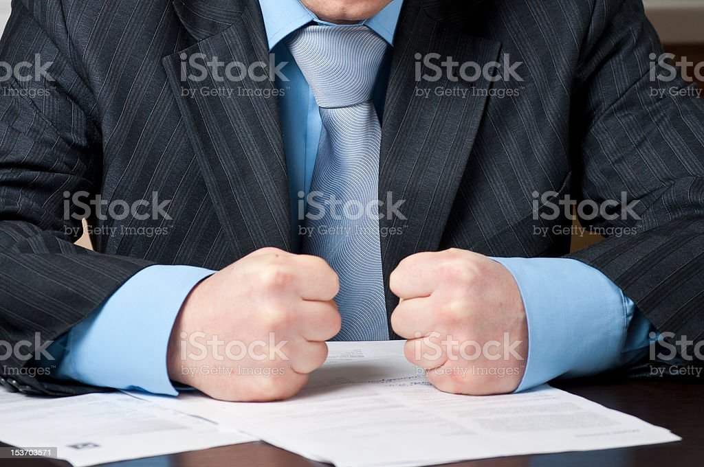 Close-up of  businessman with clenched fists. stock photo